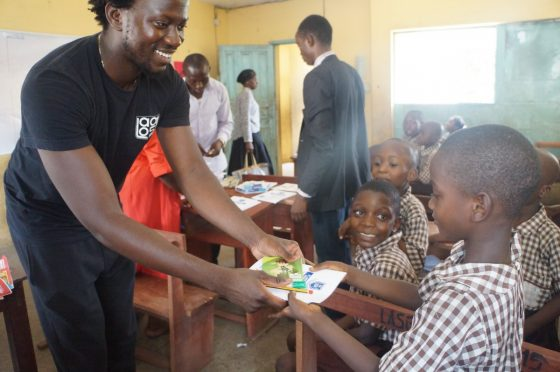 Nifemi Aluko Handing Out Stationary To Student During Lagoshats 2016 Donation